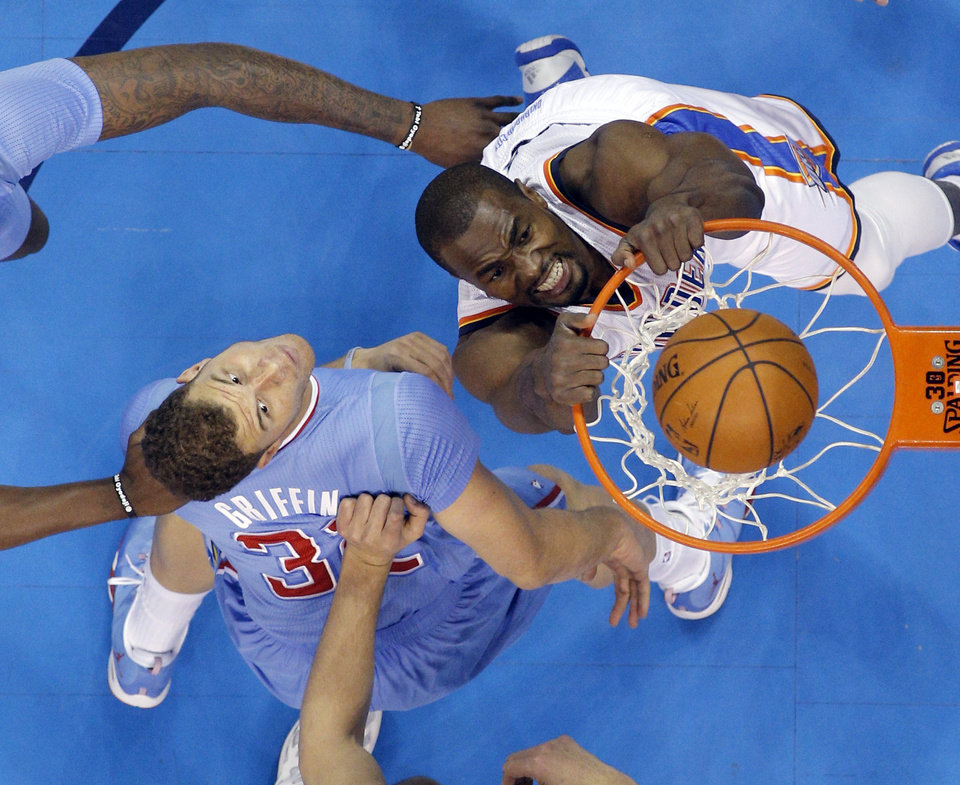 Photo - Oklahoma City 's Serge Ibaka (9) attempts a dunk over Los Angeles' Blake Griffin (32) during the NBA game between the Oklahoma City Thunder and the Los  Angeles Clippers at the Chesapeake Energy Arena, Sunday, Feb. 23, 2014. Photo by Sarah Phipps, The Oklahoman