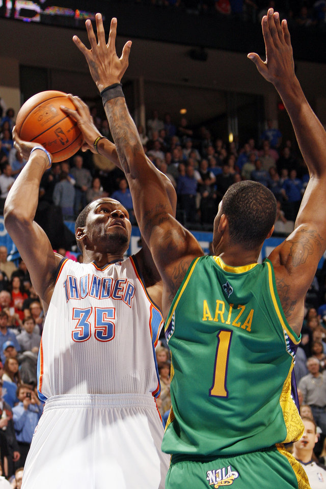 Photo - Oklahoma City's Kevin Durant (35) shoots over New Orleans' Trevor Ariza (1) during an NBA basketball game between the Oklahoma City Thunder and the New Orleans Hornets at the Chesapeake Energy Arena in Oklahoma City, Monday, Feb. 20, 2012. Photo by Nate Billings, The Oklahoman