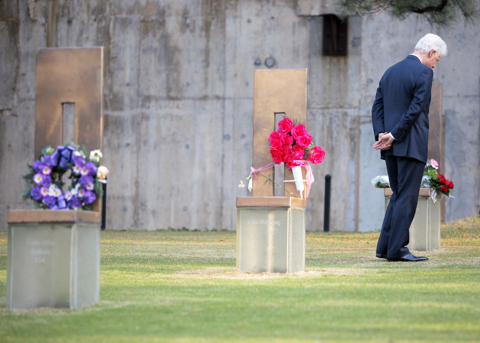 Photo - ALAN WHICHER: Former President Bill Clinton walks through the Field of Empty Chairs, away from the chair of Oklahoma City bombing victim Alan G. Whicher, of the U.S. Secret Service, after lying a bouquet of flowers on the chair during a visit to the Oklahoma City National Memorial & Museum in Oklahoma City, Wednesday, April 21, 2010. Clinton is in town to accept the sixth annual Reflections of Hope Award for his work in helping Oklahoma City transform following the bombing of the Alfred P. Murrah Federal Building 15 years ago and for his international peace work during his presidency and over the past decade.  (AP Photo/Bryan Terry, Pool) ORG XMIT: OKSO105