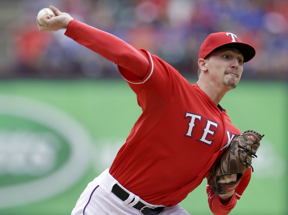Photo - Texas Rangers starting pitcher Tanner Scheppers delivers the ball to Philadelphia Phillies during the fourth inning of an opening day baseball game at Globe Life Park, Monday, March 31, 2014, in Arlington, Texas.  (AP Photo/Tony Gutierrez)