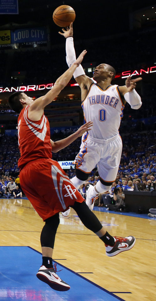 Photo - Oklahoma City's Russell Westbrook (0) shoots against Houston's Jeremy Lin (7) during Game 1 in the first round of the NBA playoffs between the Oklahoma City Thunder and the Houston Rockets at Chesapeake Energy Arena in Oklahoma City, Sunday, April 21, 2013. Oklahoma City won, 120-91. Photo by Nate Billings, The Oklahoman