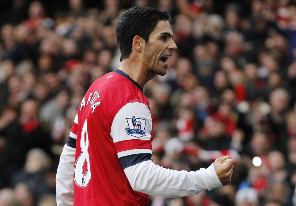 Photo -   Arsenal's Mikel Arteta celebrates his goal against Queens Park Rangers during their English Premier League soccer match at Emirates stadium, London, Saturday, Oct. 27, 2012. (AP Photo/Sang Tan)