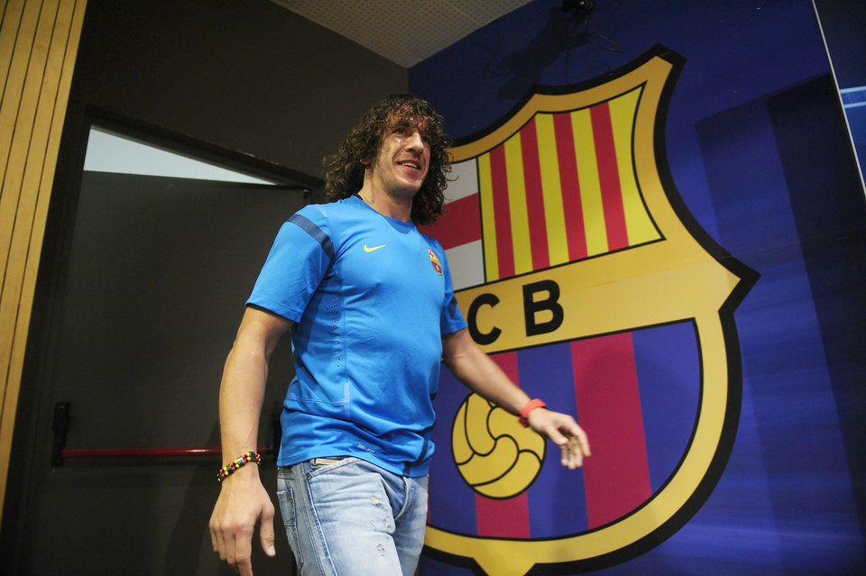 File - In this April 2, 2012 file photo, FC Barcelona's Carles Puyol arrives to give a press conference at the Nou Camp stadium in Barcelona, Spain. Barcelona defender Carles Puyol will undergo knee surgery, the Spanish league club said Tuesday May 8, 2012, ruling the Spain international out of next month's European Championship. Barcelona said the surgery will be performed on Saturday and Puyol will need six weeks to recover, dealing Spain a major defensive setback ahead of its bid to become the first nation to defend its European title after winning the 2010 World Cup. (AP Photo/Manu Fernandez, File)