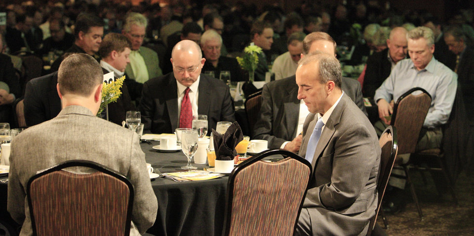 Photo -  People bow in prayer Tuesday at the 31st annual Metro Prayer Breakfast in downtown Oklahoma City. Photo by Paul B. Southerland, The Oklahoman   PAUL B. SOUTHERLAND