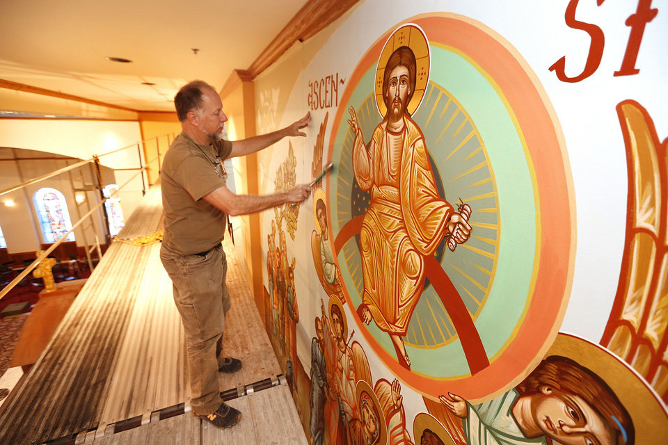 Photo - Nick Papas places iconography he painted on canvas onto a wall at St. Elijah Orthodox Christian Church, 15000 N May.  The Oklahoman - Steve Gooch