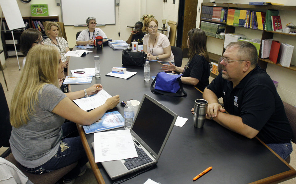 Photo - Teachers have a strategy meeting at Webster Middle School in Oklahoma City, OK, Friday, May 4, 2012. This is for a story about the life of a middle school.  By Paul Hellstern, The Oklahoman