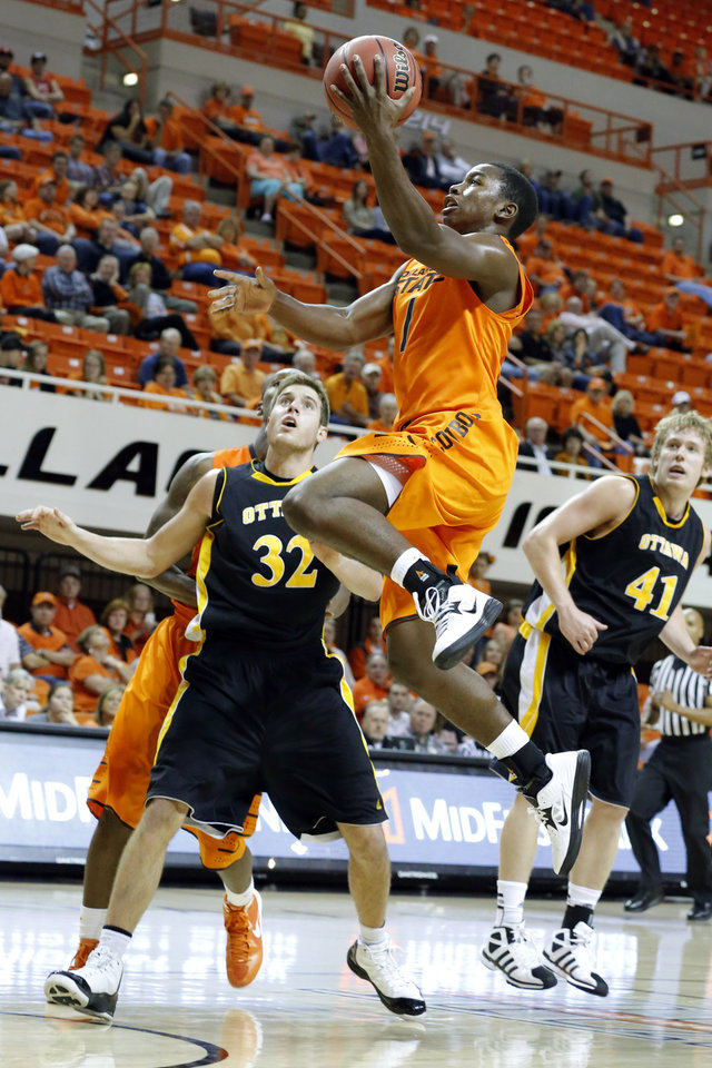 Oklahoma State\'s Kirby Gardner shoots a lay up in front of Ottawa\'s Stephen Feighny during the college basketball game between Oklahoma State University and Ottawa (Kan.) at Gallagher-Iba Arena in Stillwater, Okla., Thursday, Nov. 1, 2012. Photo by Sarah Phipps, The Oklahoman