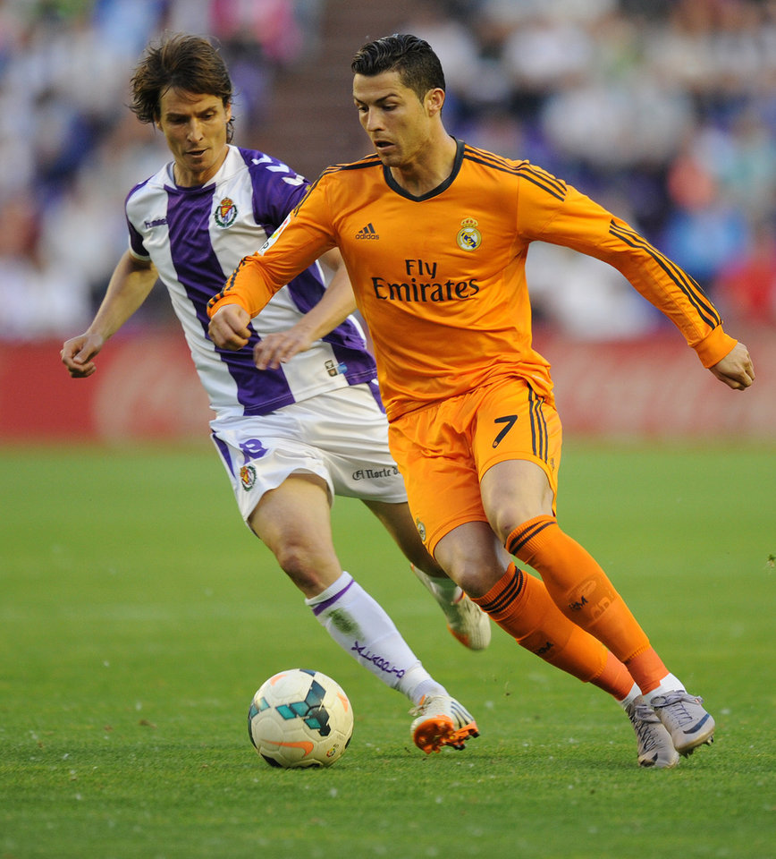 Photo - Real Madrid's Portuguese forward Cristiano Ronaldo, right,  vies for the ball with Valladolid's Diego Marino, during a Spanish La Liga soccer match at the Jose Zorrilla stadium in Valladolid, Spain, Wednesday, May 7, 2014. (AP Photo/Israel L. Murillo)