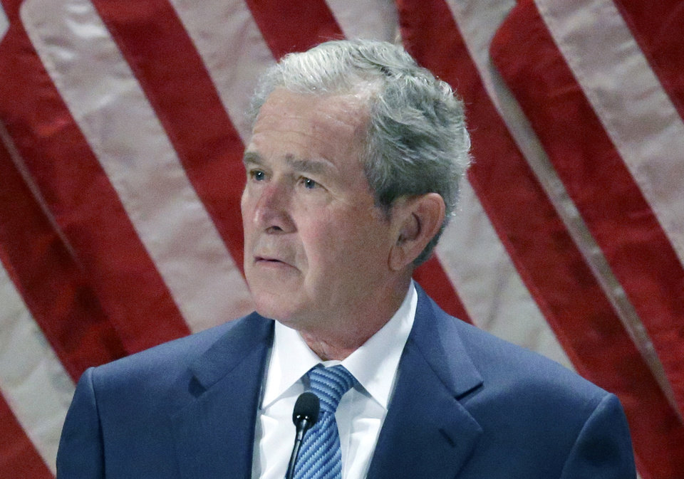 """Photo - FILE - This Feb. 19, 2014 file photo shows former President George W. Bush speaks at the George W. Bush Institute at Southern Methodist University in Dallas. Bush has found painting as his new passion to fill the void in his life after he left the White House. In an interview on NBC's """"Today"""" show, Bush tells his daughter, Jenna Bush Hager, """"I paint a lot because, as you know, I'm a driven person."""" (AP Photo/LM Otero, File)"""