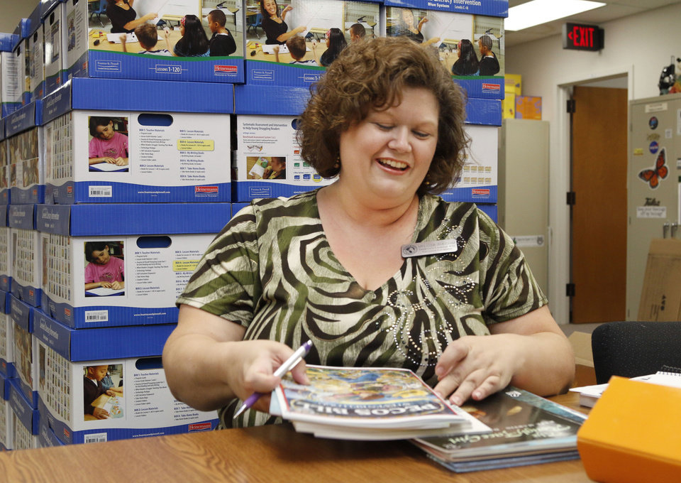 Photo - If she repeals, we have a whole lot of work to do to go back and readjust all of our curriculum to meet a different set of standards. We're talking a lot of hours.  Melissa Ahlgrim, elementary language arts curriculum coordinator for Putnam City Schools  Photo by Paul Hellstern, The Oklahoman  PAUL HELLSTERN