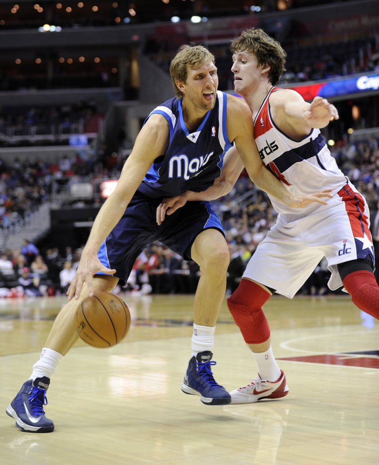 Photo - Dallas Mavericks forward Dirk Nowitzki, left, of Germany, works against Washington Wizards forward Jan Vesely, right, of the Czech Republic, during the first half of an NBA basketball game, Tuesday, Jan. 1, 2013, in Washington. (AP Photo/Nick Wass)