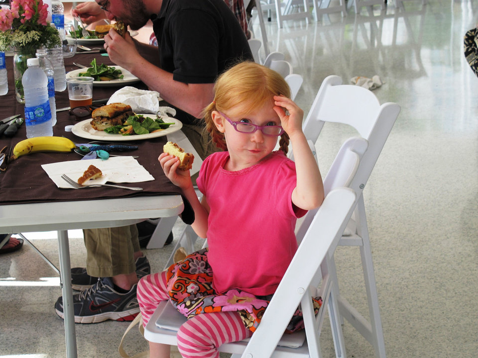 Photo - Elise Cooper enjoys lunch at Sunday's portion of the OK Chefs Relief Pop-Up Restaurant in the Myriad Botanicals Gardens event space. All proceeds were donated to the Oklahoma Chapter of the American Red Cross.  DAVE CATHEY - THE OKLAHOMAN