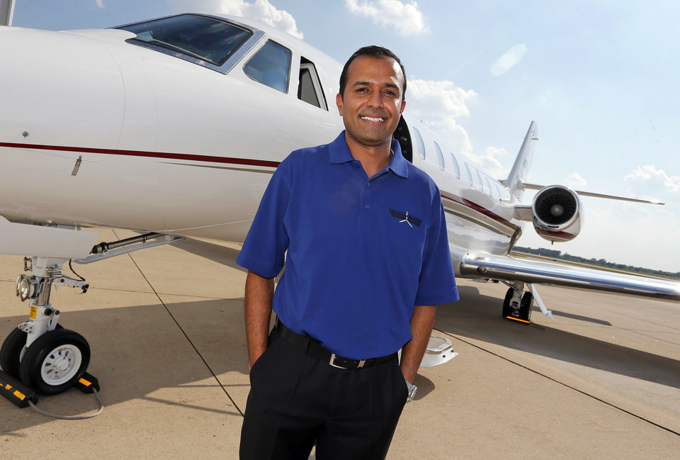 Photo -  Sho Kassam, president of Oklahoma Aviation, stands in front of a Cessna Citation Sovereign+ jet. [Photo by Nate Billings, The Oklahoman]