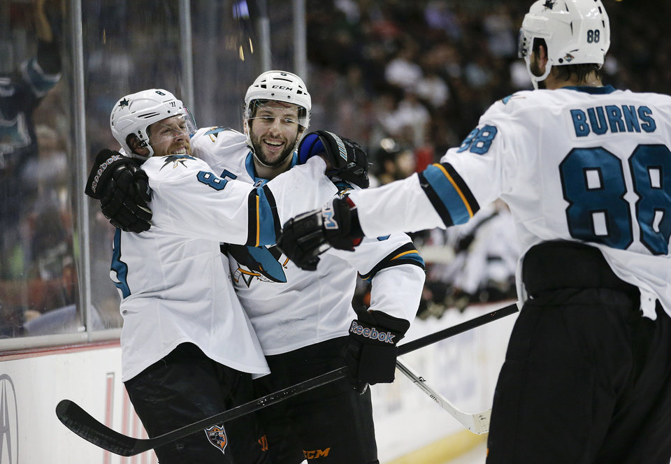 Photo - San Jose Sharks' Jason Demers, center, celebrates his goal with Joe Pavelski, left, and Brent Burns during the first period of an NHL hockey game against the Anaheim Ducks on Wednesday, April 9, 2014, in Anaheim, Calif. (AP Photo/Jae C. Hong)