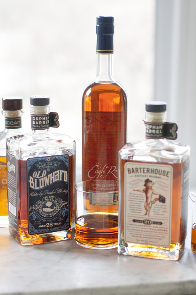 Photo - This Apr. 7, 2014 photo shows Jefferson's Ocean, Old Blowhard, Eagle Rare, and Barterhouse bourbons in Concord, N.H. All are part of a bourbon renaissance that has seen a new appreciation of American whiskey, as well as the birth of a whole new class of cult spirits. (AP Photo/Matthew Mead)