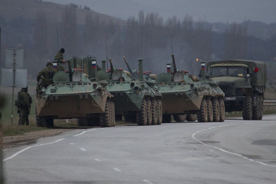 Photo - Russian armored personnel carriers and a truck are parked on the side of the road near the town of Bakhchisarai, Ukraine, Friday, Feb. 28, 2014. The vehicles were parked on the side of the road near the town of Bakhchisarai, apparently because one of them had mechanical problems. (AP Photo/Ivan Sekretarev)