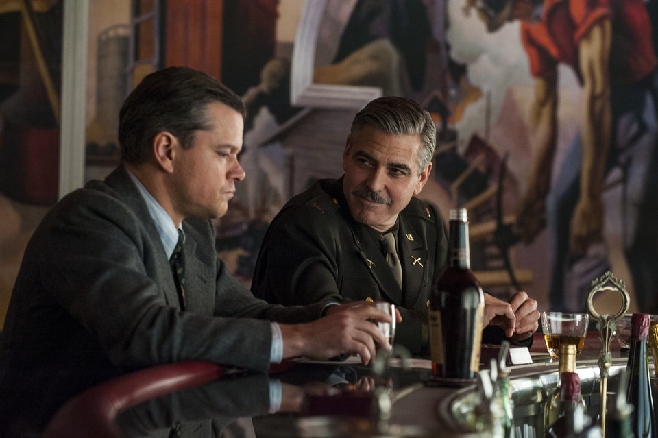 Photo - This image released by Columbia Pictures shows Matt Damon, left, and George Clooney in