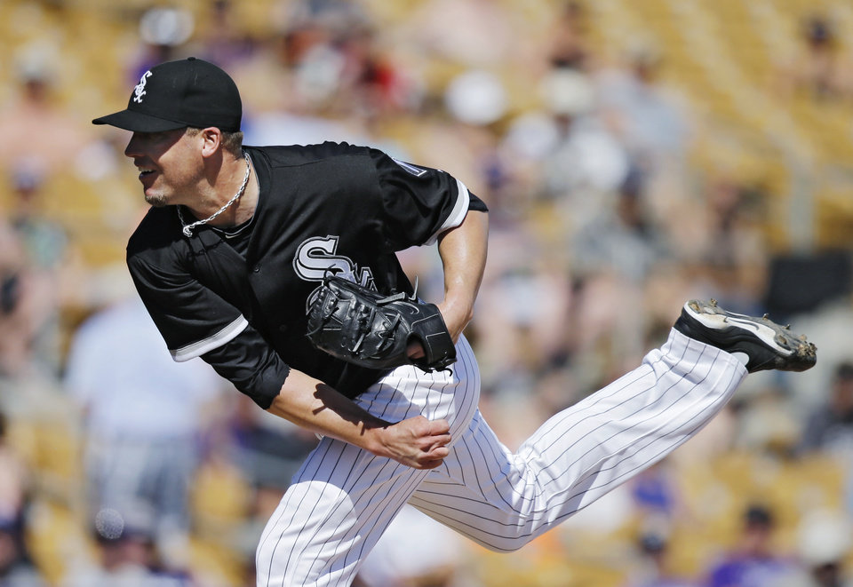 Photo - Chicago White Sox relief pitcher Matt Lindstrom follows through on a delivery to the Colorado Rockies in the sixth inning of a spring exhibition baseball game Tuesday, March 25, 2014, in Glendale, Ariz. (AP Photo/Mark Duncan)