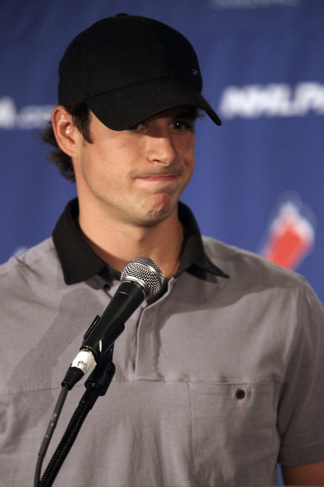 Photo -   Pittsburgh Penguins hockey player Sidney Crosby speaks to reporters during a news conference in New York, Thursday, Sept. 13, 2012. With a lockout looking increasingly certain, the NHL players' union meets Thursday followed by an owners' meeting at league headquarters with Commissioner Gary Bettman. (AP Photo/Mary Altaffer)