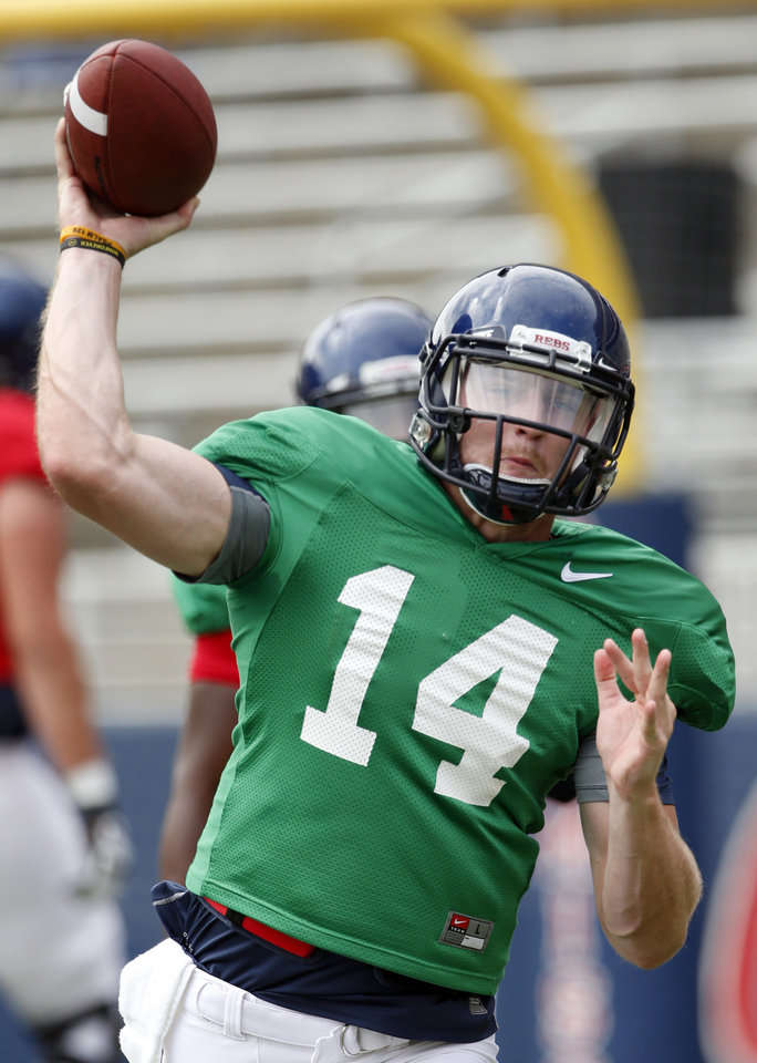 Photo - In this Aug. 9, 2014 photo, Mississippi quarterback Bo Wallace passes during the team's final open NCAA college football practice, in Oxford Miss. Wallace, now in his third year as the starter will be counted on to lead his team as they face Boise State in their season opener on Thursday, Aug. 28. (AP Photo/Rogelio V. Solis)