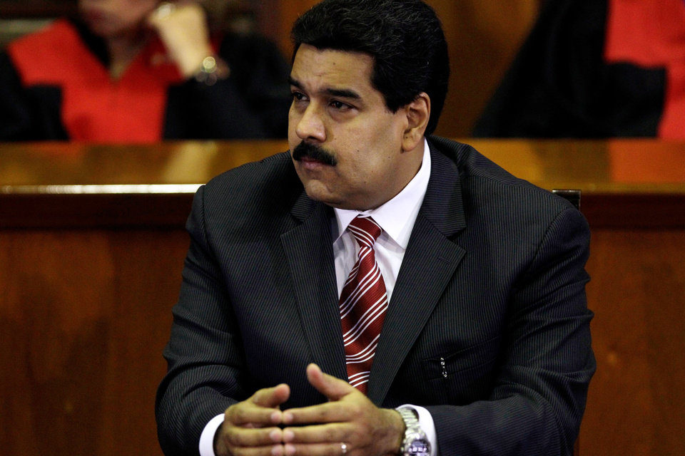 Photo - Venezuela's Vice President Nicolas Maduro listens a speech by Luisa Estella Morales, president of Supreme Court, during a special session marking the start of the judicial year in Caracas, Venezuela, Monday, Jan. 21, 2013. Maduro said Sunday he's optimistic that President Hugo Chavez will soon return to Venezuela following cancer-related surgery in Cuba. (AP Photo/Fernando Llano)