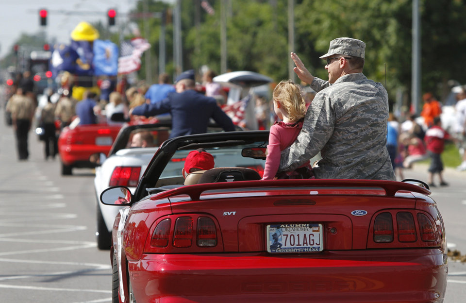 Air Force Col. Steven Bleymaier and his daughter, Caroline, 5, ride on the back seat of a Mustang in the parade. Bleymaier is commander for the 72nd Air Base.  Wing. He is the base commander for Tinker AFB.  Del City and eastern Oklahoma County residents lined S. Sunnylane Road  to show their support for America's military,  applauding and cheering  participants who marched and rode in the city's Armed Forces Day Parade on Saturday morning, May, 19, 2012. The parade worked its way along the Del City route for a little more than an hour.  Photo by Jim Beckel, The Oklahoman