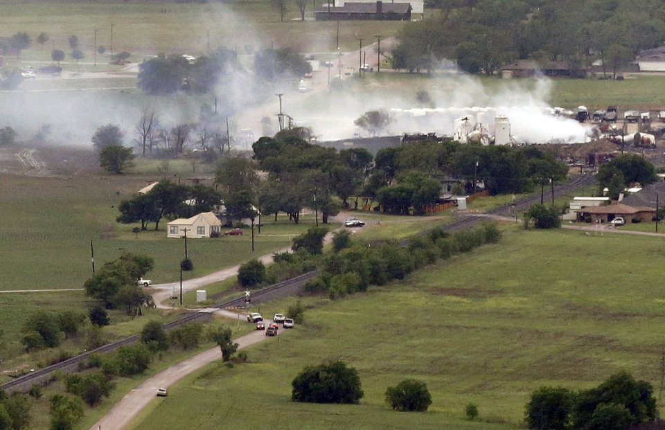 Photo - This aerial photo shows a view of homes on the North side of the fertilizer plant explosion site Thursday, April 18, 2013, in Near West, Texas.  A massive explosion at the West Fertilizer Co. killed as many as 15 people and injured more than 160, officials said overnight.  The explosion that struck around 8 p.m. Wednesday, sent flames shooting into the night sky and rained burning embers and debris down on shocked and frightened residents.  (AP Photo/Tony Gutierrez)