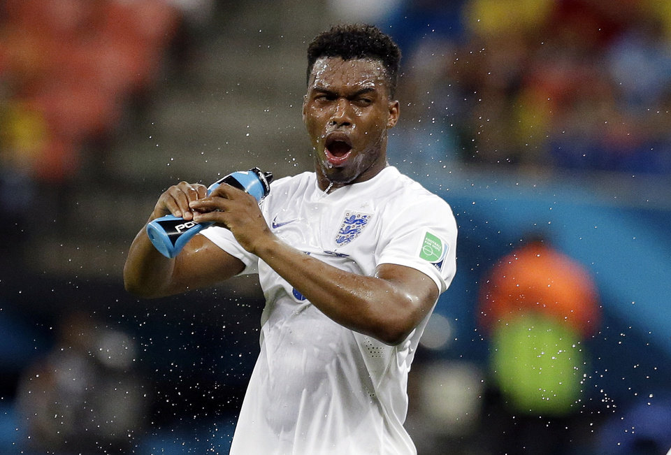 Photo - England's Daniel Sturridge douses himself down during the group D World Cup soccer match between England and Italy at the Arena da Amazonia in Manaus, Brazil, Saturday, June 14, 2014.  (AP Photo/Matt Dunham)