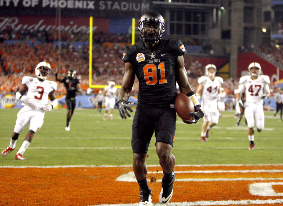 Photo - Oklahoma State's Justin Blackmon (81) celebrates a touchdown during the Fiesta Bowl between the Oklahoma State University Cowboys (OSU) and the Stanford Cardinal at the University of Phoenix Stadium in Glendale, Ariz., Monday, Jan. 2, 2012. Photo by Sarah Phipps, The Oklahoman