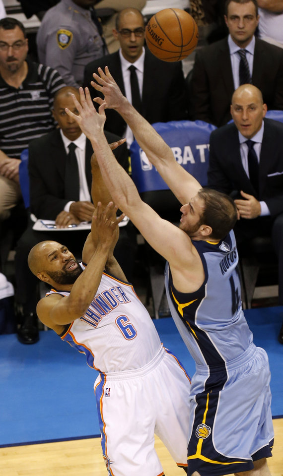 Photo - Oklahoma City's Derek Fisher (6) shoots over Memphis' Kosta Koufos (41) during Game 5 in the first round of the NBA playoffs between the Oklahoma City Thunder and the Memphis Grizzlies at Chesapeake Energy Arena in Oklahoma City, Tuesday, April 29, 2014. Photo by Nate Billings, The Oklahoman