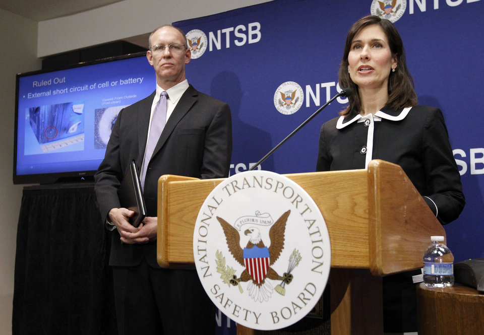 Photo - National Transportation Safety Board (NTSB) Chair Deborah Hersman, right, accompanied by John DeLisi, director of NTSB Office of Aviation Safety, speaks during a news conference in Washington, Thursday,  Feb. 7, 2013, to provide an update on the NTSB's investigation into the Jan. 7 fire that occurred on a Japan Airlines Boeing 787 at Logan International Airport in Boston. (AP Photo/Ann Heisenfelt)