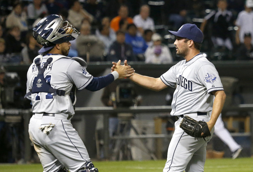 Photo - San Diego Padres catcher Rene Rivera, left, and relief pitcher Huston Street celebrate the Padres' 4-1 win over the Chicago White Sox in an interleague baseball game Friday, May 30, 2014, in Chicago. (AP Photo/Charles Rex Arbogast)