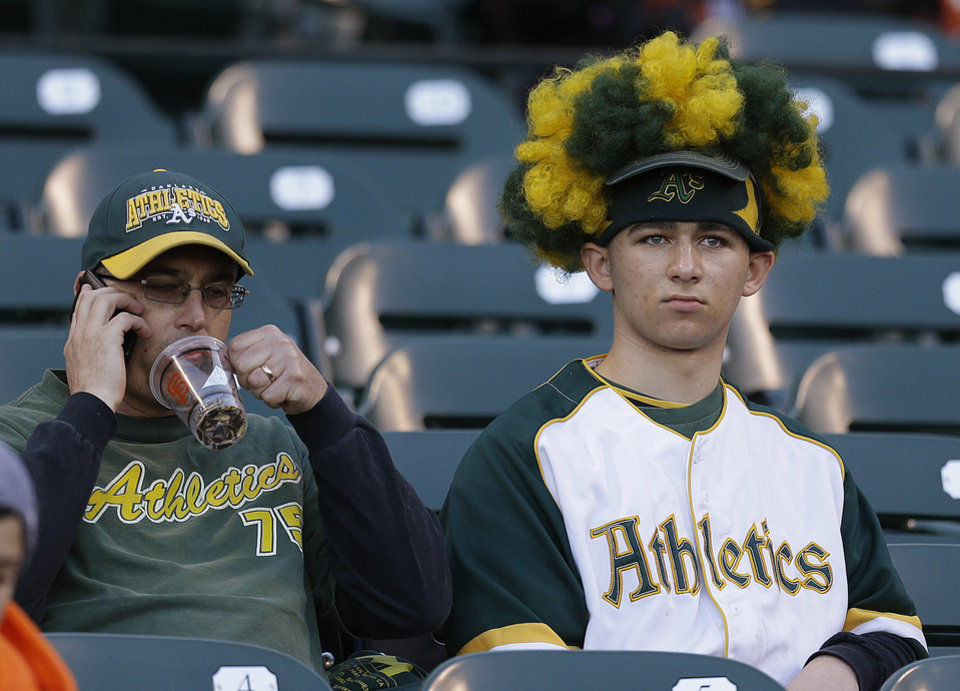 Photo - Oakland Athletics fans wait for the exhibition spring training baseball game to start against the San Francisco Giants Thursday, March 28, 2013, in San Francisco. (AP Photo/Ben Margot)