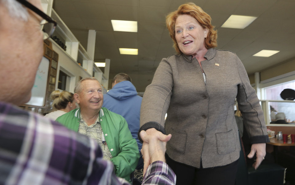 Democratic U.S. Senate candidate Heidi Heitkamp, right, shakes hands with Leroy McCann as John Russman looks on during a campaign stop at Granny's Restaurant in Grafton, N.D, Monday, Nov. 5, 2012. Heitkamp is running against Republican Rick Berg for the North Dakota's U.S Senate seat. (AP Photo/LM Otero)