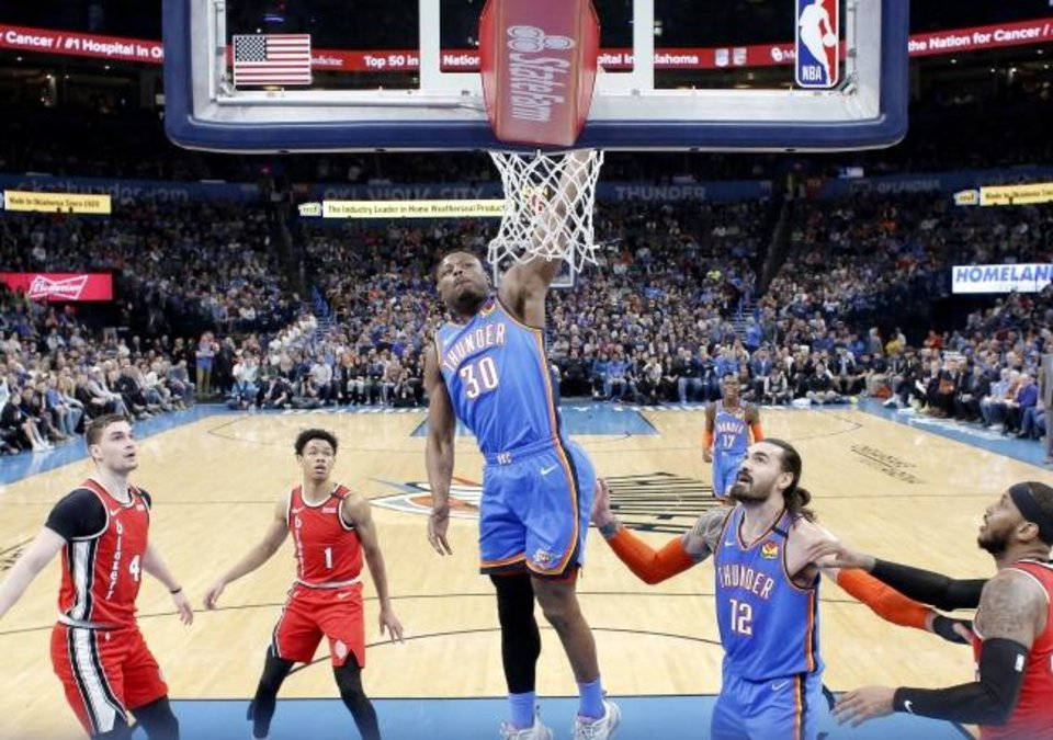 Photo -  Deonte Burton (30) dunks the ball during the Thunder's 119-106 win against the Trail Blazers on Saturday at Chesapeake Energy Arena. [Sarah Phipps/The Oklahoman]