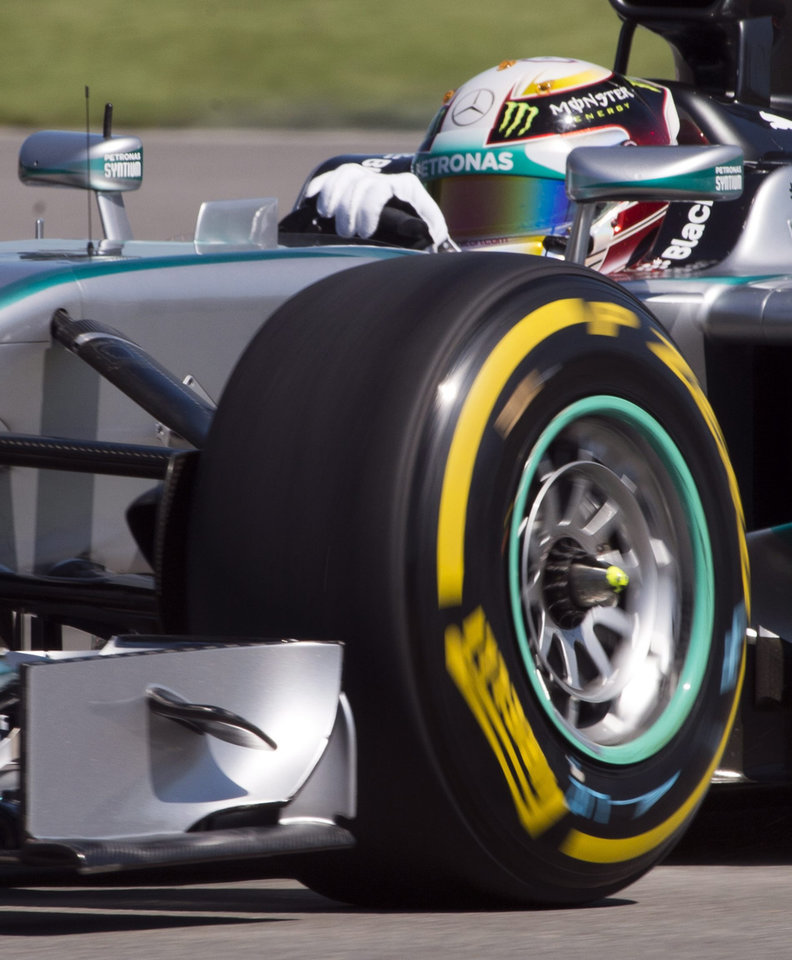 Photo - Mercedes driver Lewis Hamilton from Great Britain drives through the Senna corner during the morning practice session at Circuit Gilles Villeneuve Saturday, June 7, 2014 in Montreal. The Canadian Grand Prix will be held Sunday, June 8, 2014. (AP Photo/The Canadian Press, Ryan Remiorz)