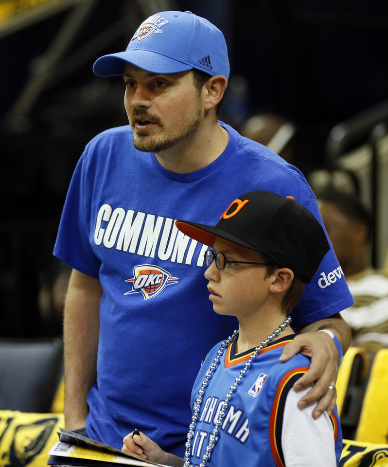 Photo - Thunder fans Steve Byrom and his son Austin Byrom, 11, of Fayetteville, Ark., watch the Thunder warm up before Game 4 of the second-round NBA basketball playoff series between the Oklahoma City Thunder and the Memphis Grizzlies at FedExForum in Memphis, Tenn., Monday, May 13, 2013. Photo by Nate Billings, The Oklahoman