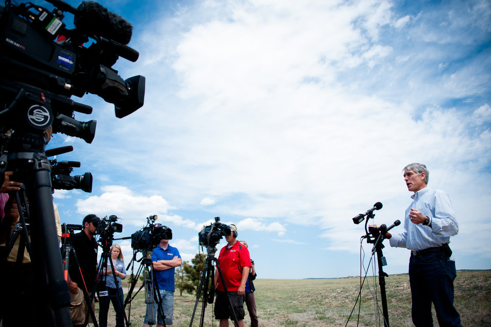 Colorado Senator Mark Udall talks with the media Friday, June 14, 2013 during a news conference, emphasizing his confidence that all federal resources are in place to fight the Black Forest fire and take care of the upcoming restoration efforts, on Friday, June 14, 2013 near Colorado Springs, Colo.  Little more than 36 hours after it started in the Black Forest area northeast of Colorado Springs, the blaze surpassed last June's Waldo Canyon fire as the most destructive in state history. That blaze burned 347 homes and killed two people.  Bradley thinks her home escaped the fire.  (AP Photo/The Gazette, Michael Ciaglo)