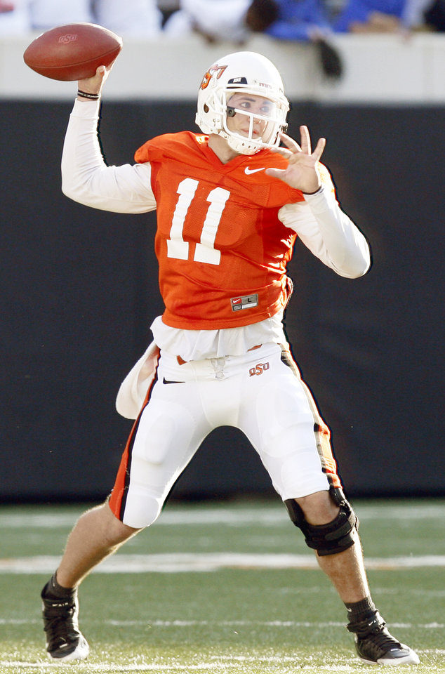 Photo - Quarterback Zac Robinson and OSU have one of the strongest 2009 season openers in the Big 12 when they host Georgia on Sept. 5. Photo by Nate Billings, The Oklahoman