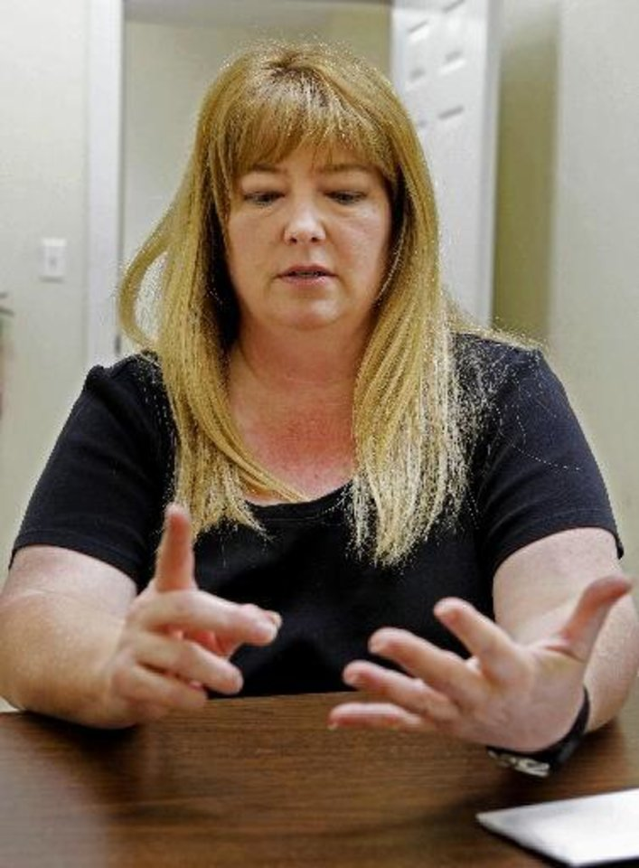 Photo - Carla McBride of the Anadarko Daily News talks about the impact the brutal daytime slaying of a pastor imore than three years ago has had on the community.  Steve Sisney