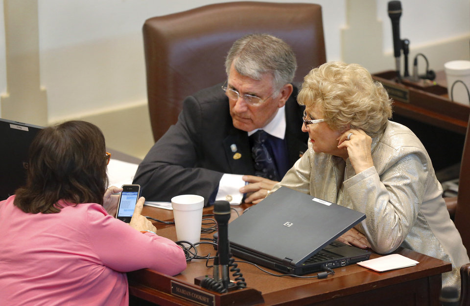 Gary Banz and Marian Cooksey talk to Lee Denney, back to camera. Following debate, members of the Oklahoma House of Representatives voted to pass HB 2630, pension overhaul legislation on Tuesday, May 20, 2014. Photo by Jim Beckel, The Oklahoman