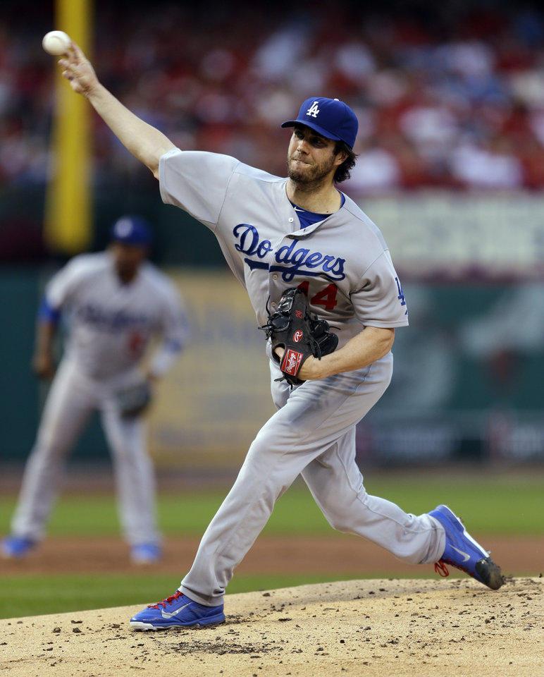 Photo - Los Angeles Dodgers starting pitcher Dan Haren throws during the first inning of a baseball game against the St. Louis Cardinals on Friday, July 18, 2014, in St. Louis. (AP Photo/Jeff Roberson)