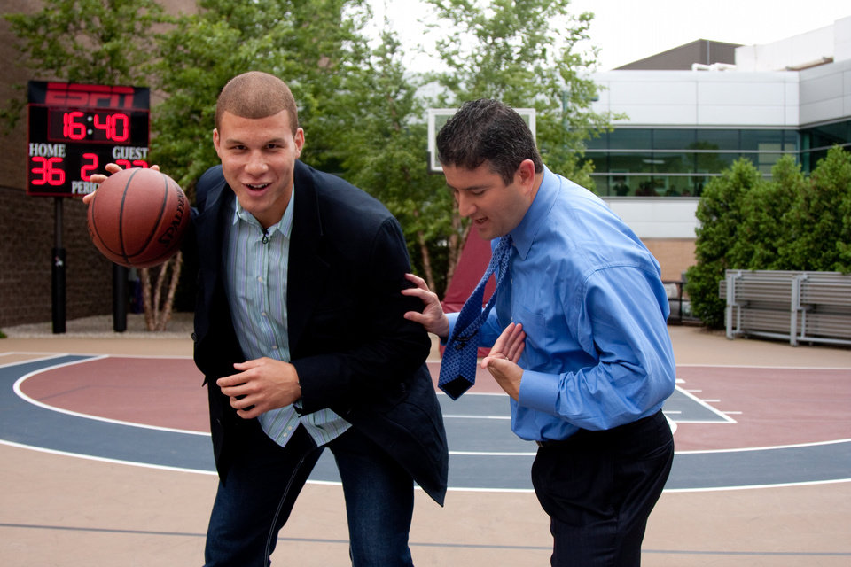 Photo - Blake Griffin is defended by ESPN basketball analyst Andy Katz during a Monday visit to ESPN headquarters. (ESPN)