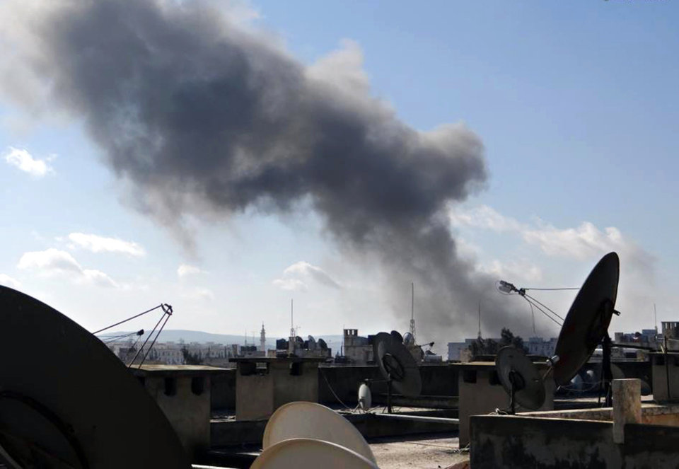 Photo - This citizen journalism image taken on Friday, Jan. 25, 2013 and provided by Aleppo Media Center AMC which has been authenticated based on its contents and other AP reporting, shows smoke rising from heavy shelling in Aleppo, Syria, Tuesday Feb. 12, 2013. Rebels captured a military air base in northern Syria on Tuesday, handing opposition fighters their second strategic victory in their nearly two-year battle against President Bashar Assad in as many days, activists said. (AP Photo/Aleppo Media Center AMC)