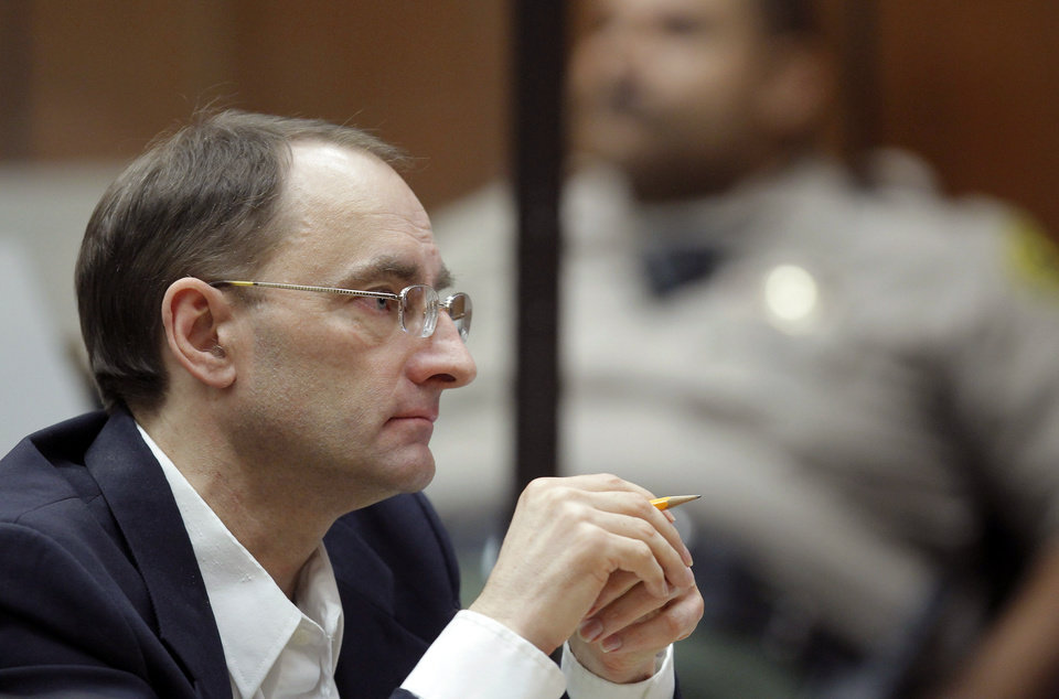 Photo - Christian Karl Gerhartsreiter, listens during opening statements in his trial, in Los Angeles Criminal Court on Monday, March 18, 2013. A prosecutor told jurors Monday he will prove a cold-case murder allegation against the German immigrant who spent years moving through U.S. society under a series of aliases, most notoriously posing as a member of the fabled Rockefeller family. He has pleaded not guilty to the killing of John Sohus, 27, who disappeared with his wife, Linda, in 1985 while Gerhartsreiter, using an alias was a guest cottage tenant at the home of Sohus' mother, where the couple lived. (AP Photo/Nick Ut )