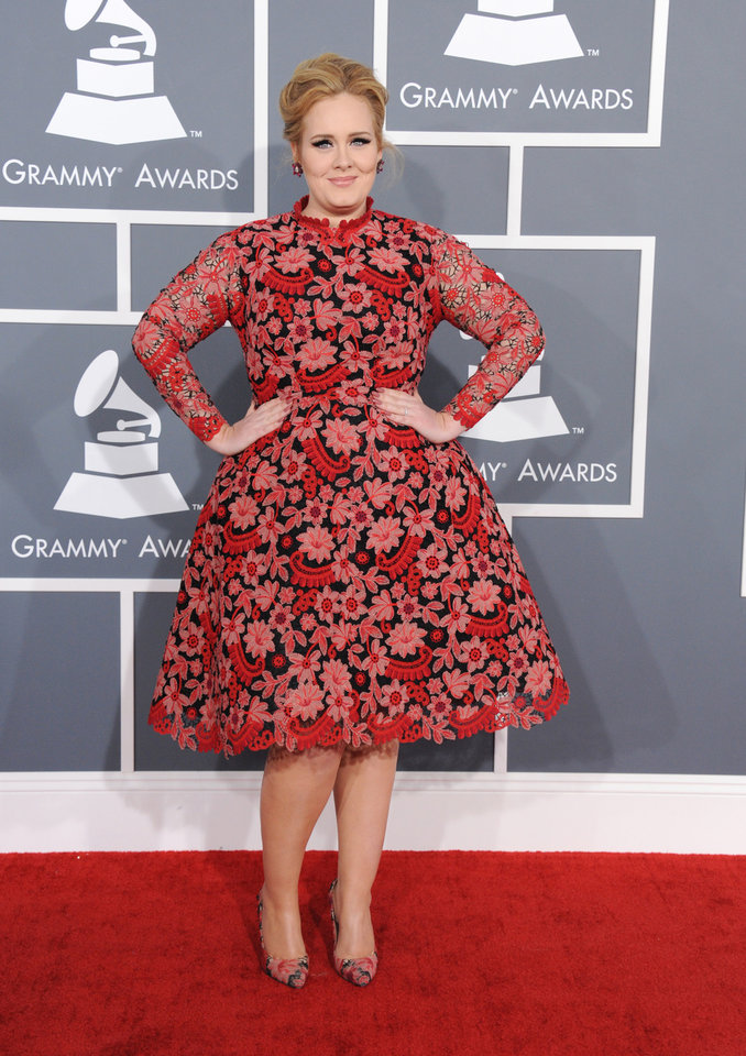 Photo - Adele arrives at the 55th annual Grammy Awards on Sunday, Feb. 10, 2013, in Los Angeles.  (Photo by Jordan Strauss/Invision/AP)