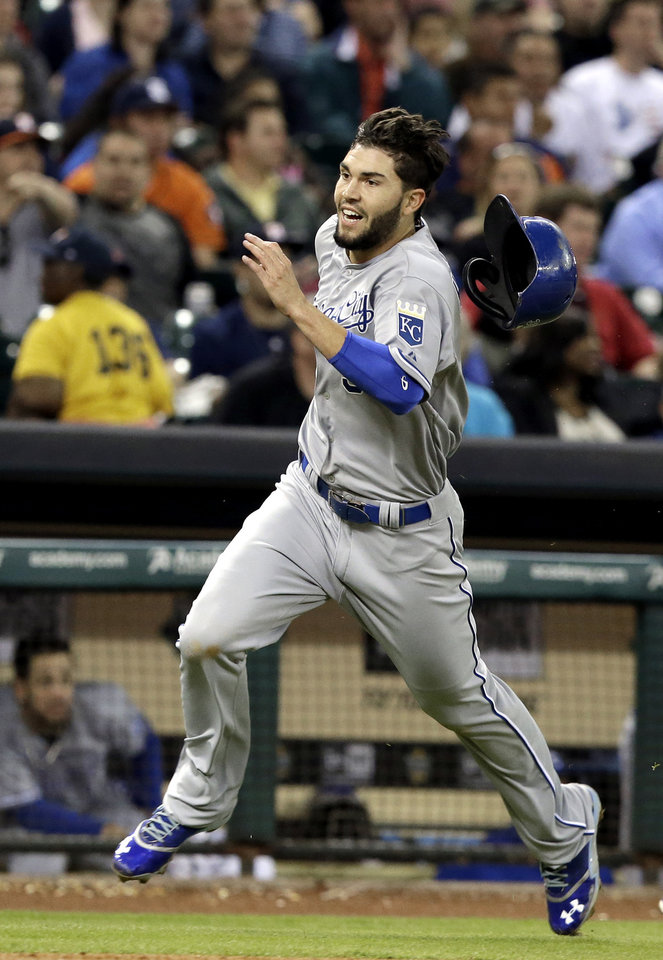 Photo - Kansas City Royals' Eric Hosmer loses his helmet as he races down the third base line while trying to score from first base on a Salvador Perez double against the Houston Astros in the fifth inning of a baseball game on Thursday, April 17, 2014, in Houston. Hosmer was tagged out at the plate. (AP Photo/Pat Sullivan)