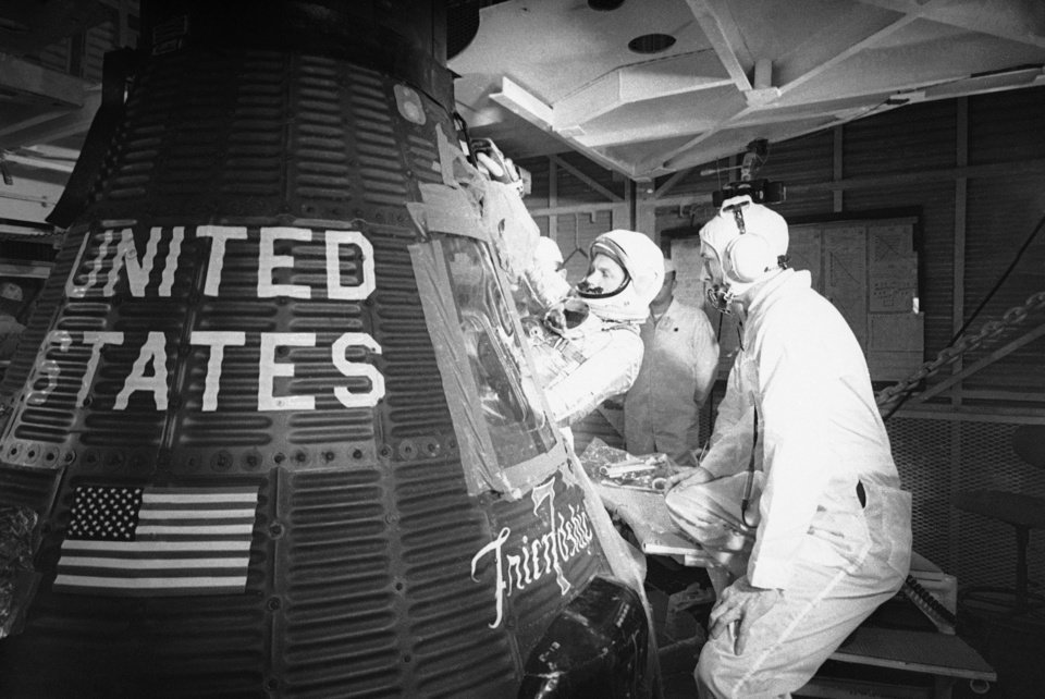 FILE - In this Jan. 2, 1962 file picture, astronaut John Glenn climbs into the