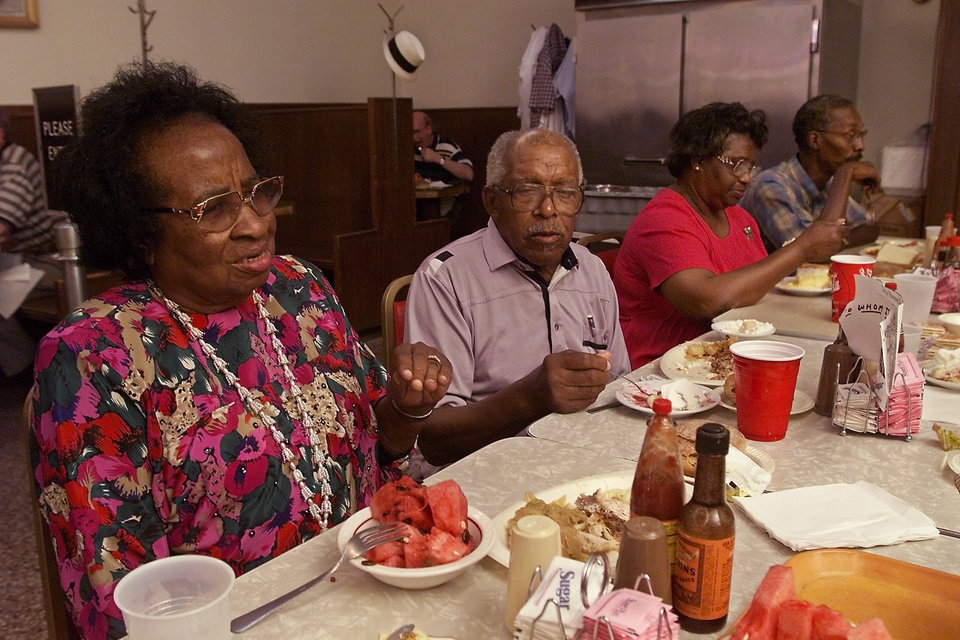 Photo - Original OKC sit in participants for August 19. Clara Luper talks while others eat lunch. Portwood Williams , Betty Germany and Richard Brown.