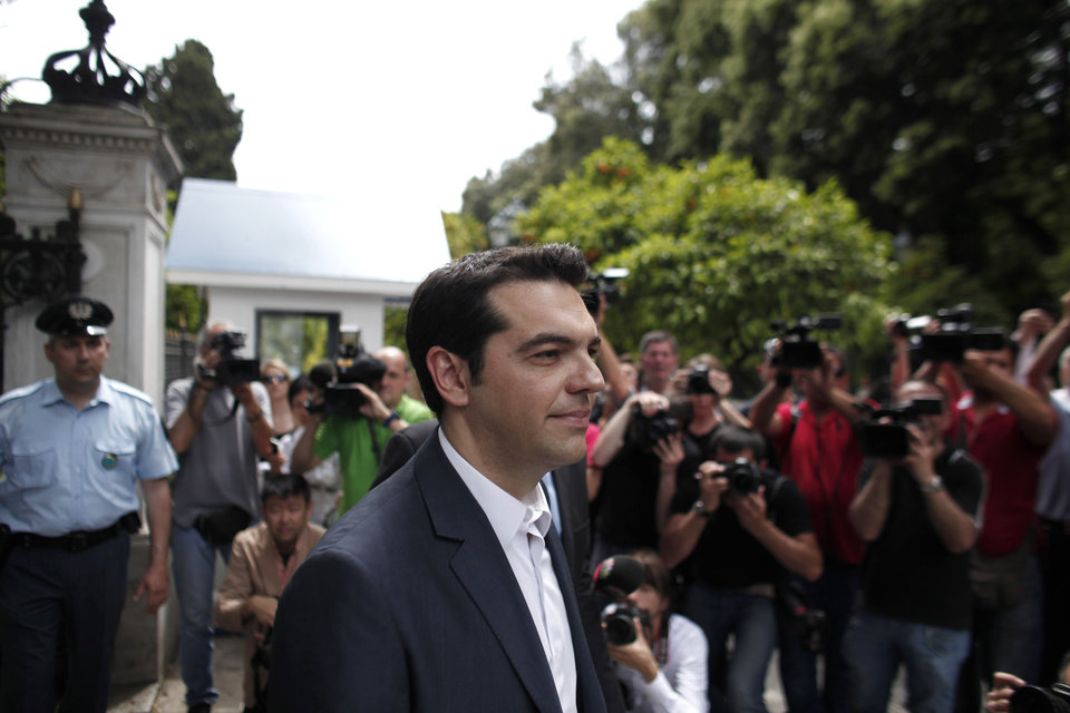 Photo -   Alexis Tsipras, head of the Radical Left Coalition (SYRIZA) exits the Presidential Palace after his meeting with Greek President Karolos Papoulias, to formally take the mandate to form a coalition government in Athens, Tuesday, May 8, 2012. Greece's commitment to austerity is no longer valid because voters have rejected those deals, a left-wing party leader declared Tuesday as he tried to form a new coalition government. (AP Photo/Kostas Tsironis)